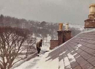 David Shovelling Snow of the Roof of Nannau in February 1963 (Courtesy of Philip Nanney Williams)