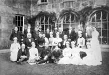 Group portrait of staff and servants at Nannau from 1888 (outside one of the now demolished pavilion wings). © Crown copyright RCAHMW.